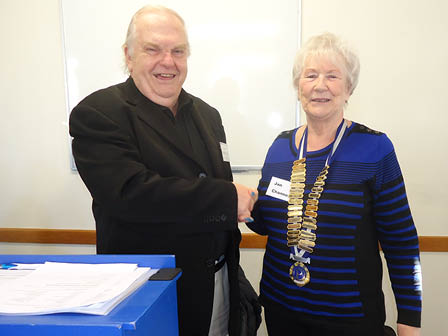Immediate Past President Dean Chandler-Mills congratulates Jan.
